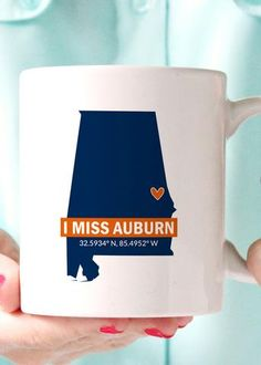 "I miss Auburn AL AU coffee mug, featuring the coordinates of your alma mater. This is the perfect gift for any Auburn grad who is feeling ""homesick"" for Auburn, Alabama. Printed in AU's pantone colors Funny Coffee Cups, Cute Coffee Mugs, Auburn Alabama, Premium Coffee, But First Coffee, Coffee Humor, Boutique, Pantone Color, I Missed"
