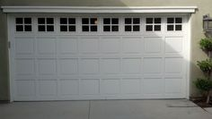 Classic white sectional with windows, recent installation by Garage Door Medics  888.870.4677