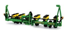 1:16 John Deere 1700 Planter by ERTL. $50.20. From the Manufacturer                Ertl, the worldwide leader in farm toys for over sixty years, is proud to offer this highly detailed replica. Featuring die cast parts, realistic details, and authentic decoration, this accurately scaled replica is sure to be a hit with collectors and fans of all ages.                                    Product Description                1/16 John Deere 1700 Planter