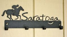 Saratoga 4 Hook Wall Mount.  Great for hats, keys, leashes, etc.  Indoor/outdoor.  Made in the USA>