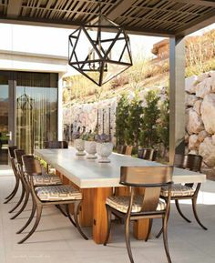 Outdoor dining space with Klismos style chairs.