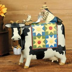 Girl on Cow with Cats Figurine