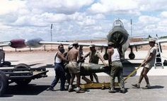 A Portuguese F-84 Thunderjet being loaded with ordnance in the 1960s at Luanda Air Base.
