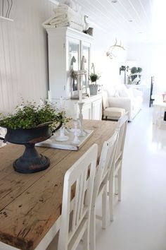 Bright White Farmhouse Dining Room With Table