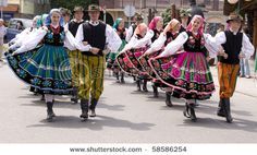 ZYWIEC, POLAND - AUGUST 5: Participants of the 47th Beskidy Highlanders Week of Culture (TKB), the biggest folk culture event in Eastern Europe, parade through the city, folk group from Poland on August 5, 2010 in Zywiec, Poland
