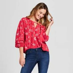 Bring a bold twist to your day with the sweet style of the Printed Woven Top from Universal Thread™. This flowy red blouse dresses things up with a keyhole cutout at the neckline, a sweet floral print and billowy sleeves. Just tuck this top into jeans for an easy way to dress up for a day out.