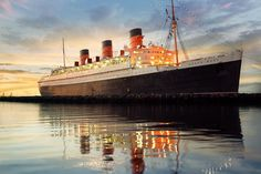 It's one of the 10 most haunted places in America, according to TIME magazine. The Queen Mary—now a full-service hotel and entertainment venue—is docked at Long Beach, California, and remains Queen Mary Hotel, Queen Mary Ship, Queen Mary Boat, Haunted Hotel, Croisière Royal Caribbean, Beat Hotel, Floating Hotel, Long Beach California, California Pictures