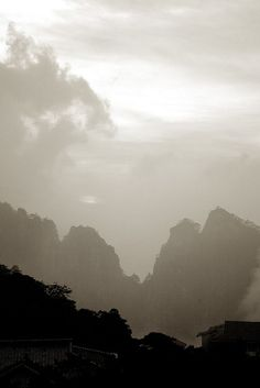 Shot from the hotel area as the sunset. You can see the peaks layering into the distant fog/cloud. Huangshan, China.