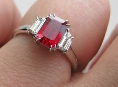 ruby, emerald cut, looks like the old stone dad had