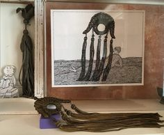 A menacing tassel, with its collected counterpart.