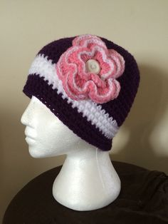 Hat with detachable flower
