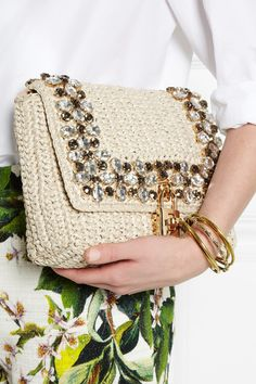 Ivory raffia Detachable adjustable leather shoulder strap (Lamb) Clear and smoky crystals, gold hardware  Internal zipped and patch pockets Fully lined in leather and leopard-print cotton-twill Twist lock-fastening padlock at front flap  Comes with dust bag