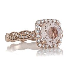 Beautiful Morganite Ring Inspired by Unified Love Designs. This is a 14kt Rose Gold with a Round Peach Morganite with Natural Diamonds side