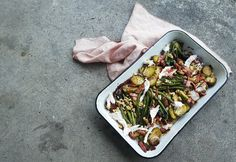 WARM SALAD of Caramelised brussel sprouts, roasted spinach crowns and bacon.