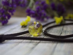 #boho #choker orb made of crystal eco-resin with realf flowers hanging on suede leather cord.  *Price 25 USD* #realflowers #leatherchoker  #resinjewelry