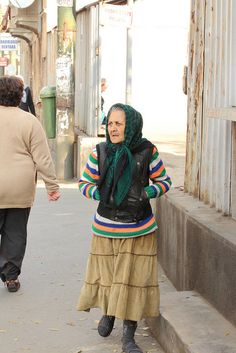 Inspiration for Jack's mom- head scarf and color palette- great distressed skirt. We Are The World, People Of The World, Prauge Czech Republic, Gypsy Women, Baylor University, Bucharest Romania, Popular Shows, Old Town Square, Medieval Town