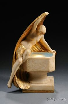 Art Deco figural lamp ~ Skinner Auction House ~ sold for $1845
