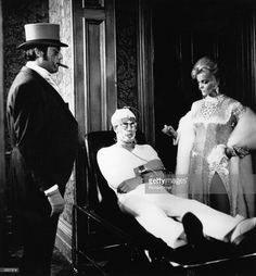 Roger Daltrey of British rock group The Who with Oliver Reed (1938 - 1999, left) and Ann-Margret in a scene from the film of Pete Townshend's rock opera 'Tommy', directed by Ken Russell. Credit: Richard Krall