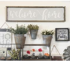 Love the galvanized buckets on the wall