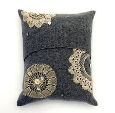 Finally a use for old doilies - and I kinda like it.. cushion with fragile doilies and buttons