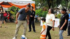 Vincent Kompany has a kick-about with a child from Taarana School, a school for children with special education needs (above). He also signed autographs for the children at the clinic. The Manchester City skipper is travelling in Asia as part of an outreach programme by the club. -- PHOTO: QNET