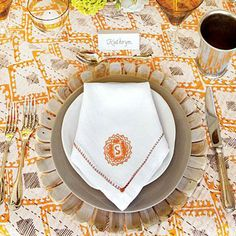 Sunny Table Setting | Ground an outdoor setting with layers of natural materials, such as these wood chargers and hand-thrown plates. | SouthernLiving.com