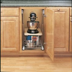 "$114  Rev-A-Shelf Heavy-Duty Mixer Lift - 60 lb max.     Cabinet Depth: 24"" Minimum     Cabinet Height: Full height with no drawer        Cabinet Frame Opening: 12-1/2"" Minimum     Shelf Size: ¾"" x 20-1/2"" length Minimum  Rockler Woodworking Tools"