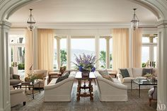 Another example of using a dining table as an end table/console table in large living spaces with two seating areas. It's so lovely. Designer - Mariette Himes Gomez Decorates a Mansion on Long Island : Interiors + Inspiration : Architectural Digest