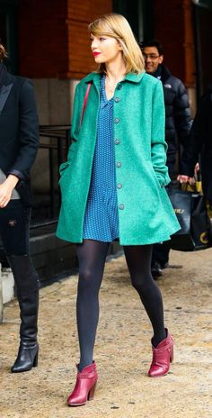 Bright Coats  Bright coats ruled street style last winter, and they're here to stay. T-Swift's teal jacket brightens the whole look, plus it complements her blue-and-red color palette perfectly. Look for blues and pinks to stay on trend this season.