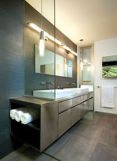 This #vanity, designed by architect and designer Janet Bloomberg, reaches into the open #shower. #bath #design