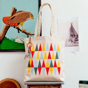 basic over the shoulder tote bag. nice idea to add a charm that would hang around the strap (although definitely not a dream catcher!). more appropriate with more luxurious materials/design