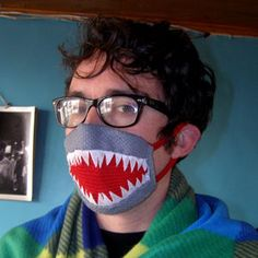 During flu season, make your health mask more fun by decorating it as a shark mouth!