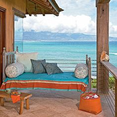 This perfect perch on Maui's North Shore is decked out with a settee and a colorful Kenyan throw | Coastalliving.com