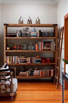Jo'burg designer Leigh Finck placed books horizontally and vertically to create a vibrant patterned effect at the end of a passage. Bookshelf Styling, Bookshelves, Bookcase, Dream House Interior, Kids Wood, Dream House Plans, Pool Houses, Modern Classic, Home Projects