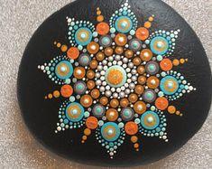 Blue and orange Indian Sun on black dot mandala