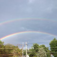 double rainbow... the fusion of nature and technology... with the wires... beauty or spoiled?