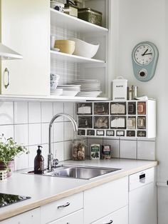 Love this! Brilliant way to mix an original built-in kitchen (upper cabinets) with modern kitchen interior (bottom cabinets). Love love love. Also: pastel colors!