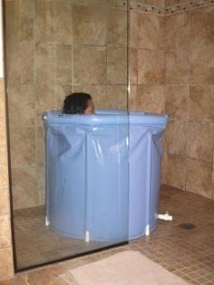 A great idea for a soaking tub in small spaces and it looks like ...