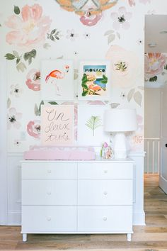 We are so excited to have the stylish Monika Hibbs with us today to share  her daughter, Lillya's unbelievable gorgeous nursery. This girly pink, yet  relaxed and comfortable space for her baby girl is what dreams are made of!  We LOVE the oversized watercolor flowered wallpaperand the beautiful