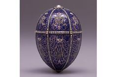 Twelve Monogram Easter Egg  Fabergé (firm); Perkhin, Mikhail (workmaster)  RUSSIA: Saint Petersburg  1895  Gold, champlevé enamel, diamonds, satin  H. 3 1/8 in., W. 2 3/16 in.  This egg was the first that Nicholas II presented to his mother, Maria Federovna.
