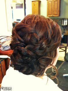 multiple braid updo this is purfect for a day at the races. It looks smart and elegant and is also practical as there is nothing worse than your hair blowing around in the wind.