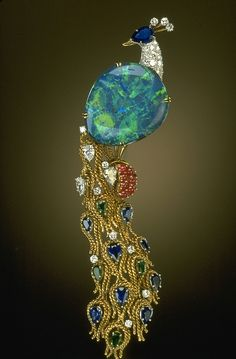 Brooch | Harry Winston.  32 ct black opal from Lightning Ridge (Australia), accented with sapphires, rubies, emeralds, and diamonds set in yellow gold.  Donated to the National Gem Collection by Harry Winston in 1977.