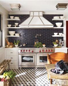I love the dark tile in the white kitchen! so dramatic!