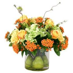"""Brighten your kitchen island or entryway console with this blooming arrangement, showcasing faux florals in a glass vase filled with lifelike pears.  Product: Faux floral arrangementConstruction Material: Silk, polyester, glass and acrylicColor: Green, yellow and orangeFeatures: Includes faux flowers and pearsDimensions: 14"""" H x 20"""" DiameterCleaning and Care: For indoor use only"""