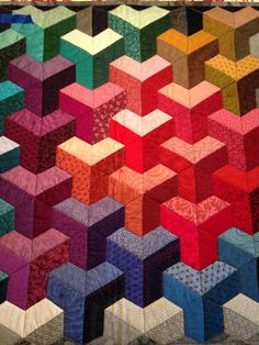 Half-Hexagon is sewn with trapezoid shapes. What an interesting effect!