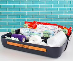 Store first aid supplies in a utensil tray to ensure organization and accessibility.