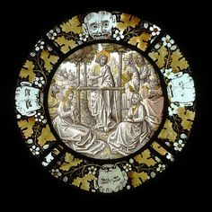 A glass roundel portraying Saint John the Baptist preaching, made in Flanders, c.1520; this Christian scene is enclosed by representations of the pagan Green Man, symbolising the spirit of nature, along with fruit and foliage. (Victoria & Albert Museum)