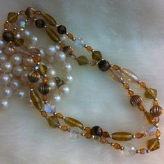 Vintage glass and metal bead necklace.. Gorgeous cut Aurora  borealis beads - round gold tone metal beads- tiger eye beads glass - gold tone metal beads mixed in with some chain. Beautiful unmarked 34 inch vintage necklace. Necklace was doubled to show off beads on manikin . Vintage Jewelry Necklaces