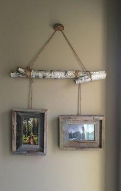Birch Tree Limb picture hanger.                                                                                                                                                                                 More #PrimitiveBedroom #LodgeDecor
