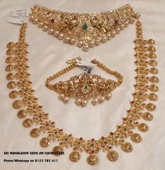 Special offer prices for full Wedding jewellery ready selection or made to order. Beautiful bridal set with lakshmi kasu haaram chiker and necklace. Contact no 8125 782 02 July 2018 Indian Wedding Jewelry, Indian Jewelry Sets, Bridal Jewelry Sets, Bridal Jewellery, India Jewelry, Temple Jewellery, Bridal Accessories, Gold Earrings Designs, Gold Jewellery Design
